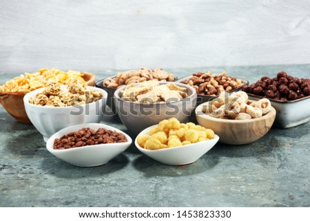 Cereal. Bowls of various cereals for breakfast. Muesli with variety of kids cereals. #1453823330