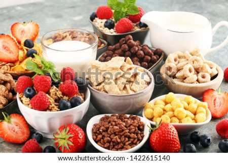 Cereal. Bowls of various cereals, fruits and milk for breakfast. Muesli with variety of kids cereals. #1422615140