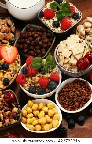 Cereal. Bowls of various cereals, fruits and milk for breakfast. Muesli with variety of kids cereals. #1422725216