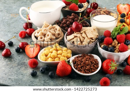 Cereal. Bowls of various cereals, fruits and milk for breakfast. Muesli with variety of kids cereals. #1422725273