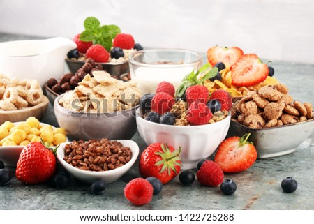 Cereal. Bowls of various cereals, fruits and milk for breakfast. Muesli with variety of kids cereals. #1422725288