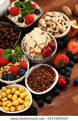 Cereal. Bowls of various cereals, fruits and milk for breakfast. Muesli with variety of kids cereals. #1427669024
