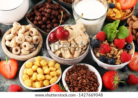 Cereal. Bowls of various cereals, fruits and milk for breakfast. Muesli with variety of kids cereals. #1427669048