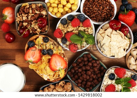 Cereal. Bowls of various cereals, fruits and milk for breakfast. Muesli with variety of kids cereals. #1429818002