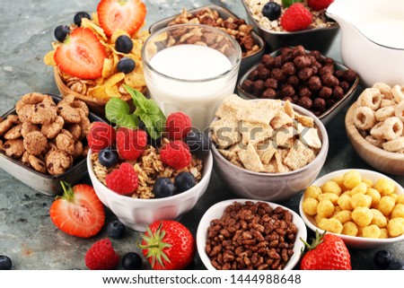 Cereal. Bowls of various cereals, fruits and milk for breakfast. Muesli with variety of kids cereals. #1444988648