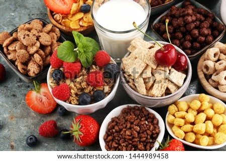 Cereal. Bowls of various cereals, fruits and milk for breakfast. Muesli with variety of kids cereals. #1444989458