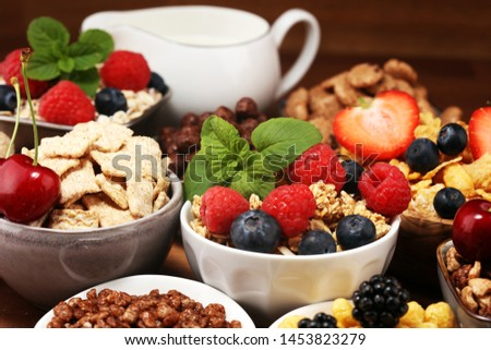Cereal. Bowls of various cereals, fruits and milk for breakfast. Muesli with variety of kids cereals. #1453823279