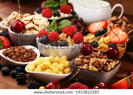 Cereal. Bowls of various cereals, fruits and milk for breakfast. Muesli with variety of kids cereals. #1453823285