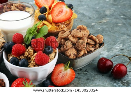 Cereal. Bowls of various cereals, fruits and milk for breakfast. Muesli with variety of kids cereals. #1453823324