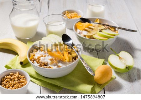 Cereal cereal with fruit and yogurt on a white wooden background. Healthy breakfast top view #1475894807