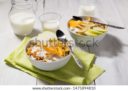 Cereal cereal with fruit and yogurt on a white wooden background. Healthy breakfast top view #1475894810