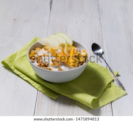 Cereal cereal with slices of fruits and yogurt on a white wooden background. Healthy breakfast top view  #1475894813