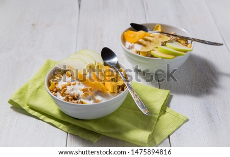 Cereal cereal with slices of fruits and yogurt on a white wooden background. Healthy breakfast top view  #1475894816
