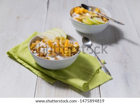 Cereal cereal with slices of fruits and yogurt on a white wooden background. Healthy breakfast top view  #1475894819