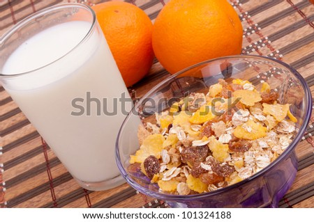 Cereal, cornflakes, dry fruits, milk and oranges for healthy breakfast