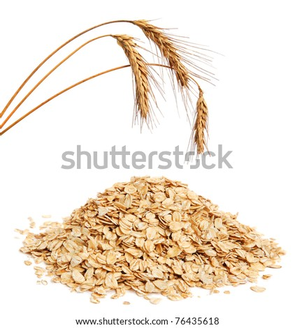 Cereal flakes and wheat ears on white background