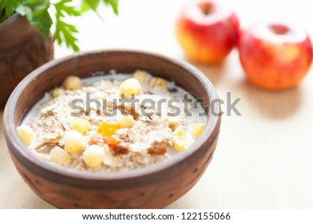 Cereal flakes with hot milk - a quick breakfast, close-up