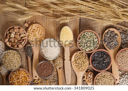 Cereal grains , seeds, beans on wooden background. #341809025