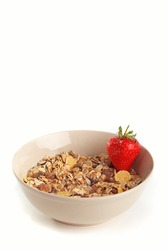 Cereal muesli in brown bowl with strawberry