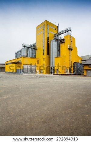 Cereal silos with a yellow building #292894913