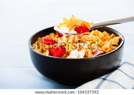 Cereal with milk and strawberries as studio shot