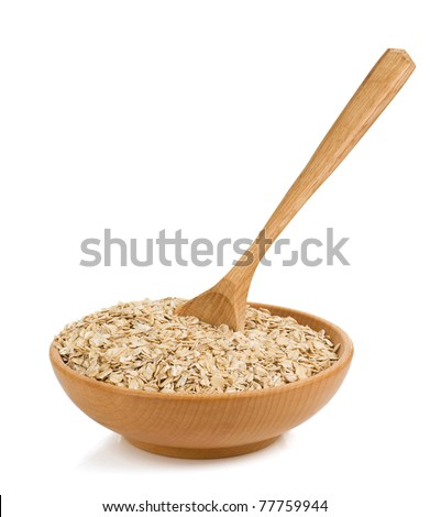 cereals flake in wood plate isolated on white background