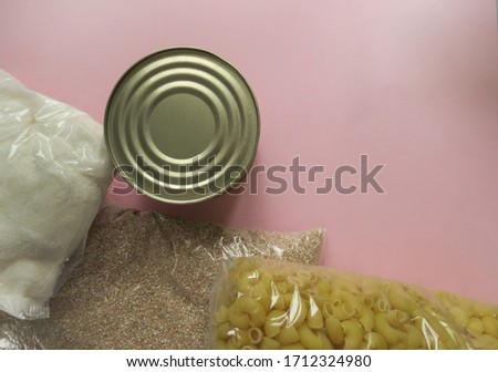 Cereals, various products, canned food, pasta and oil with place for text. Humanitarian assistance during the coronavirus pandemic. Copy space Сток-фото ©