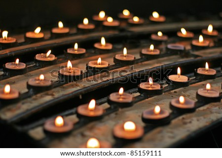 Ceremonial candles in the Catholic Church (focus on the central row of candles)