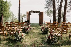 Ceremony, arch, wedding arch, wedding, wedding moment, decorations, decor, wedding decorations, flowers, chairs, outdoor ceremony in the open air, bouquets of flowers.