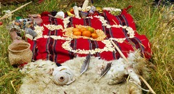 Ceremony in homage to Pachamama - indigenous ritual of the peoples Ecuador (Azuay) around a Chakana or Andean cross, made with seeds, corn, fruits and elements that allude to fire, earth, air, water.