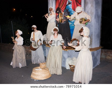 CERTALDO, ITALY - JULY 15: Unidentified men dressed as women with