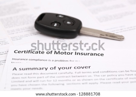 Certificate of motor insurance with car key