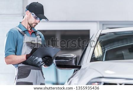 Certified Auto Service Worker Making Warranty Documentation. Vehicle Under Maintenance. Automotive Concept. #1355935436