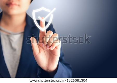 Certified Guarantee Approval or Secure Access System Concept, Business Woman is Pressing Identity Proofing Icon for Security Protection Systems on Screen. Business Financial Warranty for Investment  Foto stock ©
