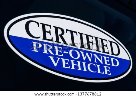 Certified Pre-Owned Vehicle sign at a used car dealership II