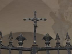 Certosa Monumental Cemetery, Ferrara, Italy. Detail of a closed top gate ending with crucifix.