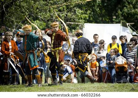 CERVENY KAMEN, SLOVAKIA - MAY 22:   members of historical archery club shoot on target at \