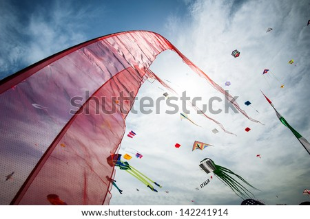 CERVIA, ITALY - APRIL 25: Sky full of kites for International Kite Festival on April 25, 2013 in Cervia. This Festival brings together kite flyers from all over the world every year since 1981.