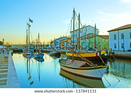 CESENATICO, ITALY- APRIL 14: antique fishing sailing boats at the harbor. The harbor designed by Leonardo da Vinci attracts thousands of tourists every month. April 14, 2013 Cesenatico Italy