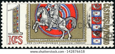 CESKOSLOVENSKO - CIRCA 1973: stamp printed in Czech republic (Czechoslovakia) shows postilion on horse with telephone and telegraph, day of Czechoslovak postage, Scott catalog 1914 A679 1k, circa 1973