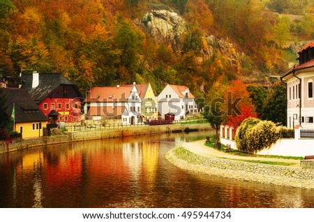 Shutterstock Cesky Krumlov - a famous czech historical beautiful town, view to the city river and beautiful autumn street with colorful buildings and fall trees. Travel european background