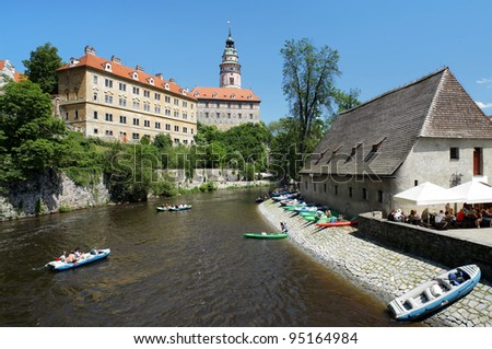 Cesky Krumlov Castle with Tower and rafting on Vltava river, Czech Republic