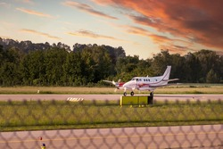 cessna, propeller plane ready to take off on the runway. private small pager plane propelled by propellers. sunset dramatic sky
