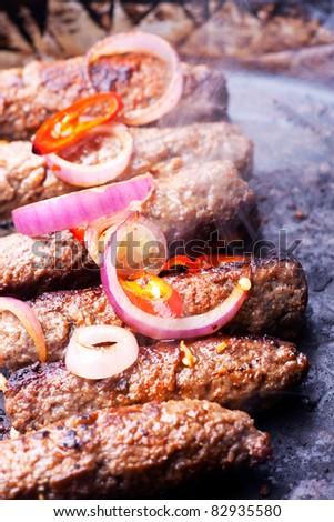 cevapcici minced meat rolls in a pan