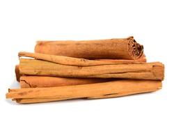 Ceylon Cinnamon or True Cinnamon Quills (Cinnamomum Verum). Also known as Sri Lanka Cinnamon or Cinnamomum Zeylanicum. Isolated on White.