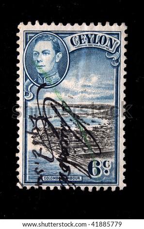 CEYLON - CIRCA 1949: A stamp printed in Ceylon (present time Sri Lanka) shows Colombo harbor and portrait of King George VI, circa 1949