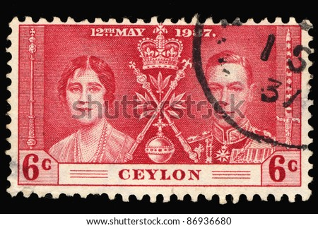CEYLON - CIRCA 1937: A stamp printed in the Ceylon shows image of King George VI and Queen consort Elizabeth Bowes-Lyon, circa 1937