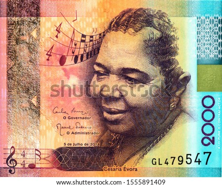 Cezaria Evora, also known as the Queen of Morna, a singer from the Cape Verde jazz style Celebrated for receiving a Grammy in 2006 for the Voz d'Amor album. on Cape Verde 2000 Escudos 2014 Bank note. #1555891409
