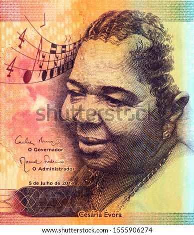 Cezaria Evora, also known as the Queen of Morna, a singer from the Cape Verde jazz style Celebrated for receiving a Grammy in 2006 for the Voz d'Amor album. on Cape Verde 2000 Escudos 2014 Bank note. #1555906274