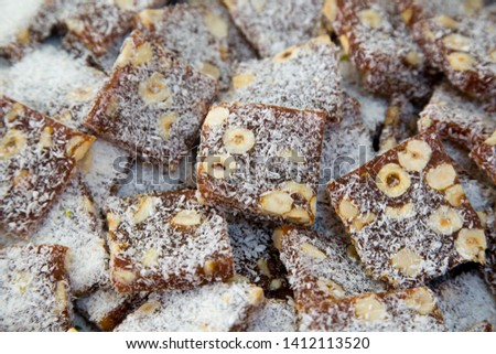 Cezerye is a traditional Turkish dessert made from caramelised carrots, shredded coconut, and roasted walnuts, hazelnuts, or pistachios. Famous dessert of Mersin with geographical sign registration.  #1412113520